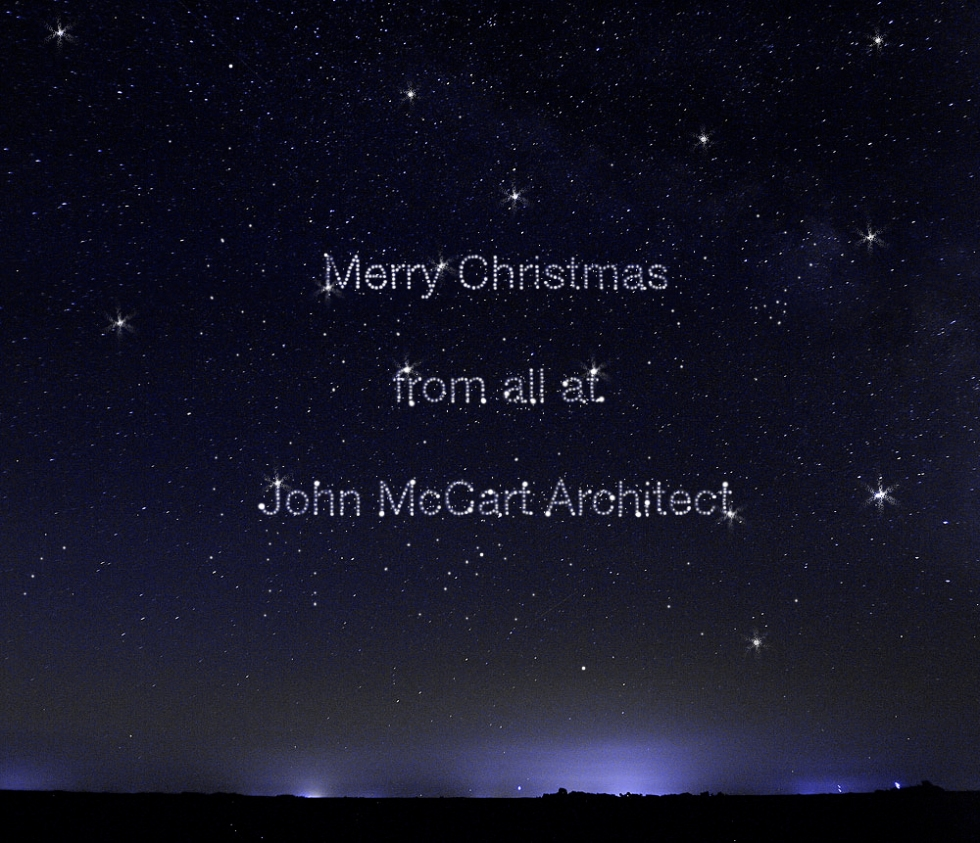 a starry sky depicting a christmas message from john mccart architect
