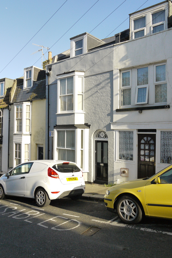 A photograph of the terraced house in Dorset Place, Hastings.
